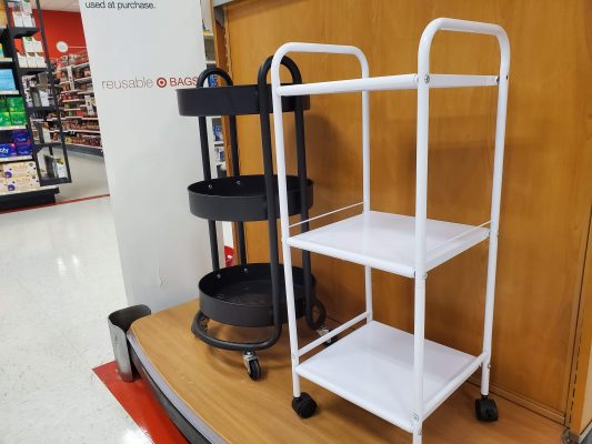 White supply cart with wheels. Black supply cart with wheels